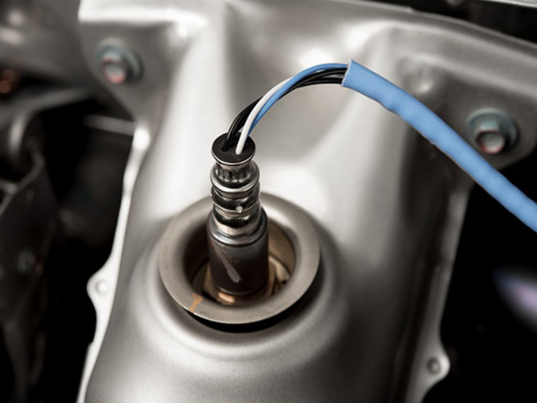 Photo of oxygen sensor on automobile.