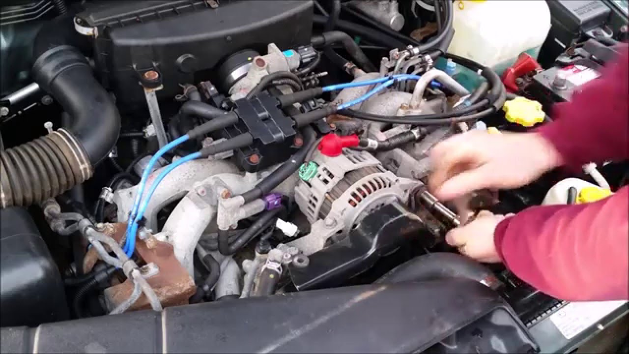 Auto alternator being installed to repair the electrical system.